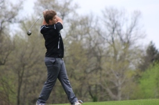 Charles City's Carter Johanningmeier launches a drive Tuesday during a four-team meet at Cedar Ridge Golf Course in Charles City. (Photo by Chris Baldus