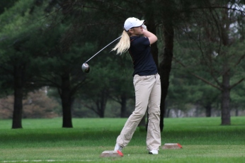 Charles City's Gen Wandro launches a drive Tuesday during a four-team meet at Cedar Ridge Golf Course in Charles City. (Photo by Chris Baldus