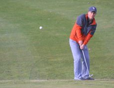 Charles City's Theo Arndt chips onto the 8th hole green Friday at the New Hampton Golf and Country Club during the Comets match against the Chickasaws, who won 156 to 168. -- Chris Baldus/North Cedar Reports