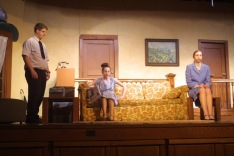 """Matthew Bottorff as Gene, Carlee Smith as Erma and Jayne Levi as Kitty rehearse Thursday for the Nashua-Plainfield spring play, """"Three's a Family."""""""