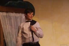 "Drew Moine as Adam rehearses Thursday for the Nashua-Plainfield spring play, ""Three's a Family."""