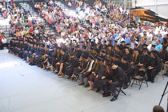 The Charles City High School Class of 2017 is seated Sunday, May 28, during its graduation ceremony in the district's competition gym. — Photo by Chris Baldus