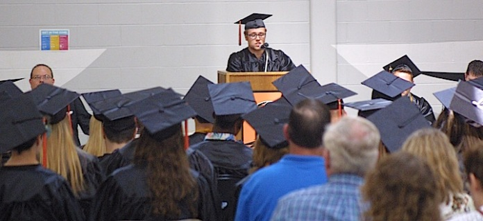 Nathaniel Adrian Reams delivers a speech Sunday during the Charles City High School graduation ceremony in the district's competition gym. —Photo by Chris Baldus