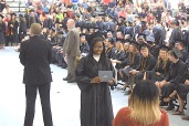 Tauna Simone Mayhorn pauses for a photograph Sunday during the Charles City High School graduation ceremony in the district's competition gym. -- Photo by Chris Baldus