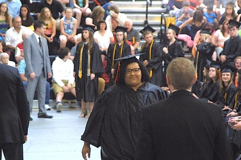 Kaylee Elizabeth Michael is congratulated by Superintendent Dr. Dan Cox on Sunday after receiving her diploma during the Charles City High School graduation ceremony in the district's competition gym. -- Photo by Chris Baldus