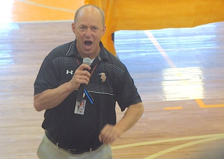 """Charles City High School associate principal Larry Wolfe leads theClass of 2021 in three rounds of the """"We Are CC"""" cheer."""