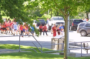 The Charles City Class of 2021 marches to the front doors of the high school on Friday.