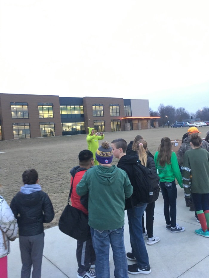 Yes, that's CCMS Principal Rick Gabel taking a photo while dressed as the Grinch.