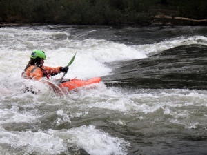 Paddler is Joseph Tyrey of Pisgah, Iowa, catches an October wave at the Charles City Whitewater Park. Tourism in Charles City has been on the rise since the opening of the state's first whitewater river park in 2011.     Photo by Hannah Ray J